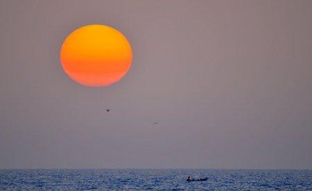 coucher de soleil mer saison des pluies au Sénégal