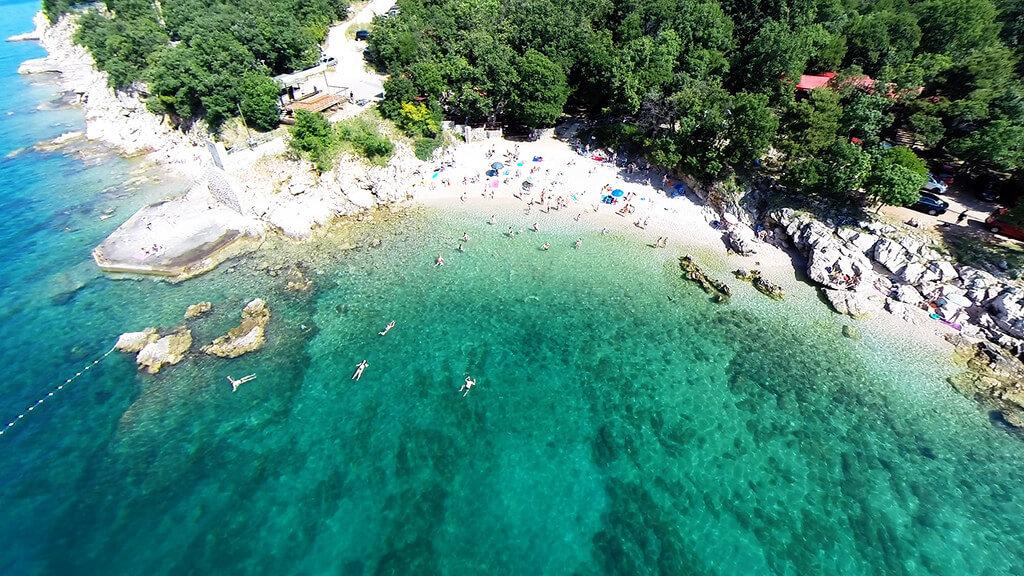 Rijeka : Beautiful beach with clear sea and people near Rijeka, Croatia