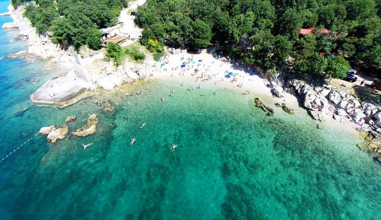Rijeka : Beautiful beach with clear sea and people near Rijeka, Croatia